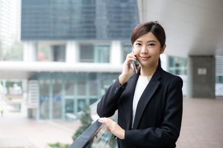 telephone saleswoman: Business woman talk to smart phone