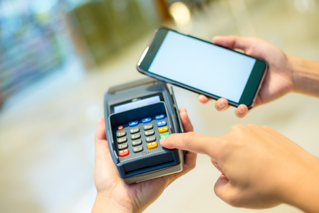 pos: Customer using cellphone for pay on pos machine