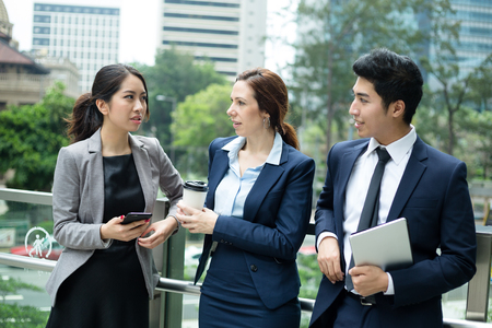 manager team: Business people talking outside office