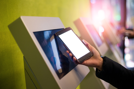 automatic transaction machine: Woman scanning on the payment machine by NFC
