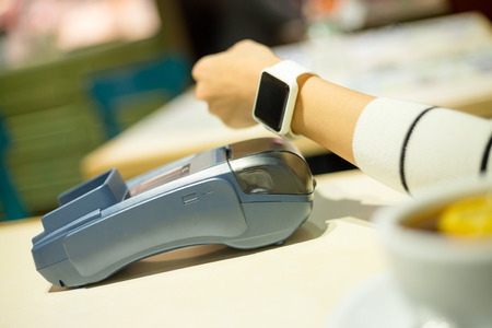 telecast: Smartwatch paying on the bill in restaurant