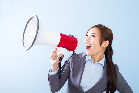 yell: Businesswoman yell with loudspeaker