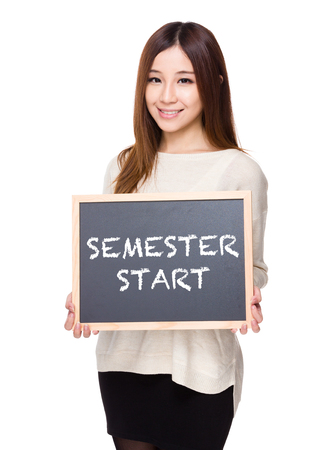 phrases: Woman hold with chalkboard showing phrases of semester start