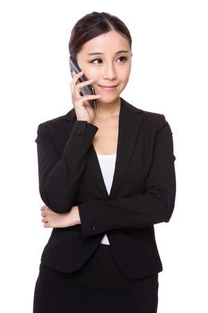 telephone saleswoman: Asian businesswoman talk to mobile phone