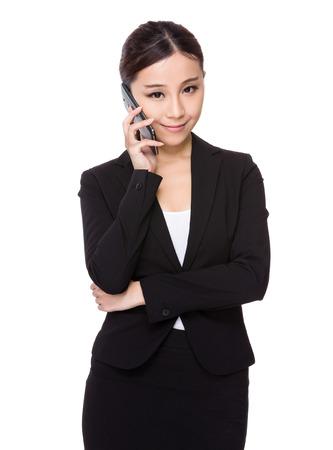 telephone saleswoman: Businesswoman talk to cellphone Stock Photo
