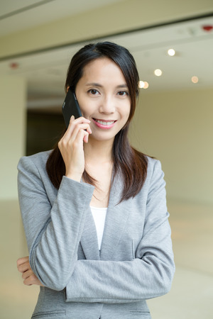 phone business: Business woman chat on phone Stock Photo