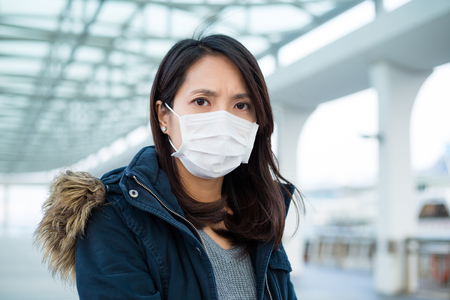 transmissible: Woman suffer from illness and wearing face mask