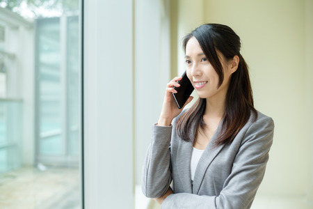 phone business: Business woman talk to phone Stock Photo