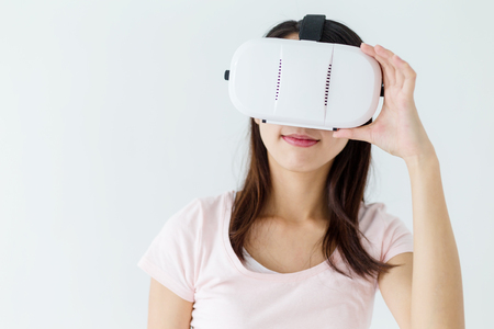 though: Woman looking though vr device