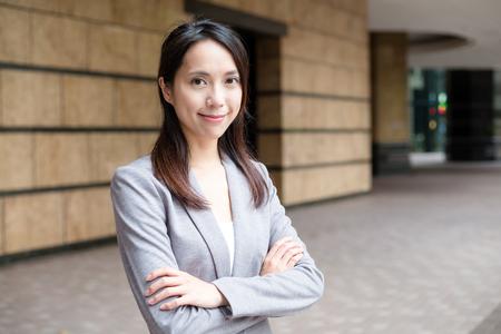 businesswoman standing: Businesswoman standing outside