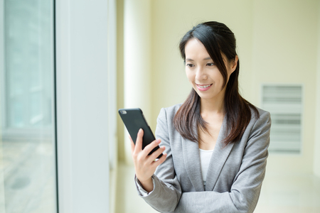 phone professional: Woman use of mobile phone at office