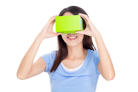 though: Woman experience though virtual reality device Stock Photo