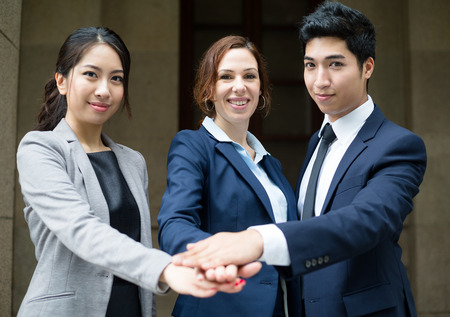 joining: Business people hand joining