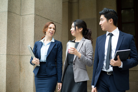 chinese american ethnicity: Business people walking at outdoor