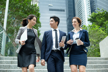 chinese american ethnicity: Business people walking outside office