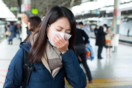 transmissible: Woman feeling sick in train platform