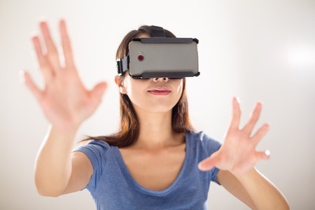 Young Woman wearing virtual reality device Reklamní fotografie