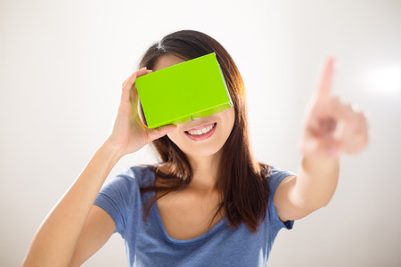 pointing device: Woman wearing with VR device and finger pointing on air