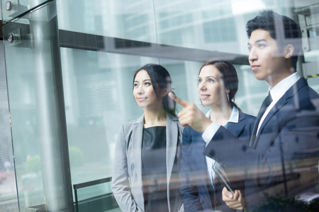 chinese american ethnicity: Business people discussing the target Stock Photo