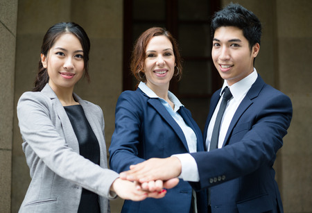 joining hands: Business team joining hands Stock Photo