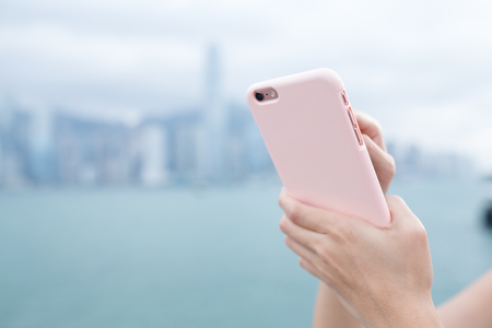 body parts cell phone: Woman using cellphone browsing online