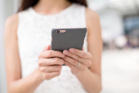 woman on phone: Woman browsing mobile phone Stock Photo