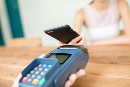 checkout: Woman checkout by mobile phone