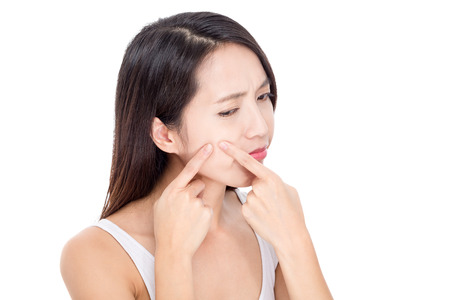 blackhead: Young woman Squeezing pimple Stock Photo