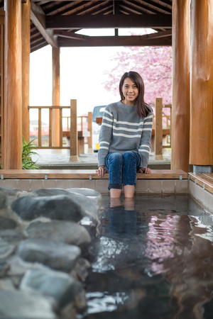 wetting: Woman relaxing on foot onsen