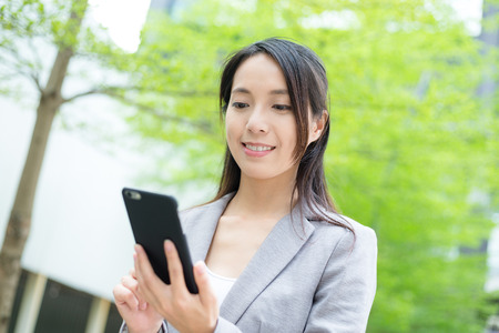 asian executive: Business woman use of mobile phone Stock Photo