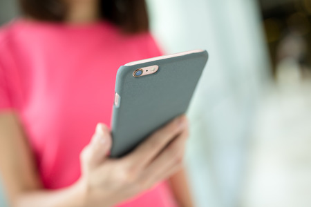 woman on phone: Woman holding a phone Stock Photo