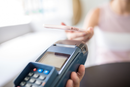 paying: Paying with smartphone Stock Photo