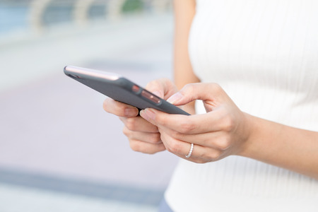 body parts cell phone: Woman use of mobile phone