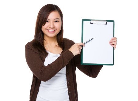 working woman: Young woman pen point to clipboard Stock Photo