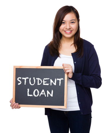 show bill: Woman showing the chalkboard with showing phrase of student loan Foto de archivo
