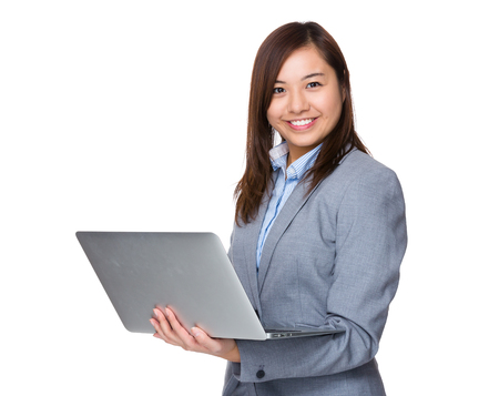 working on computer: Businesswoman working with laptop computer Stock Photo