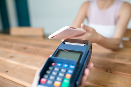 accepting: Worker accepting payment from customer through NFC