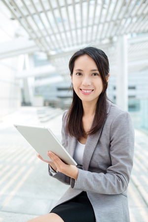 topicality: Business woman with tablet pc Stock Photo