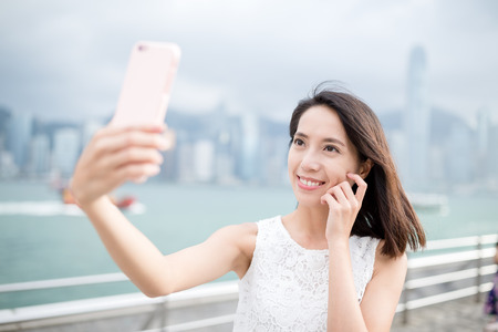 self image: Woman taking self image by mobile phone
