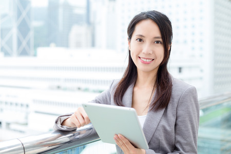 topicality: Business woman use of tablet pc