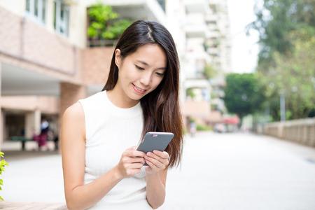 woman on phone: Woman holding smart phone Stock Photo