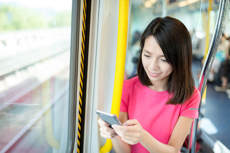 compartment: Woman use of cellphone at train compartment