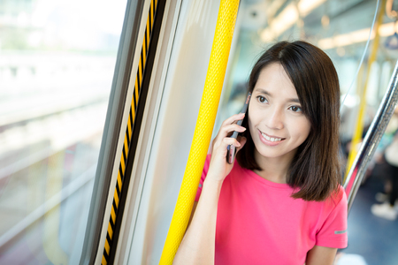 compartment: Woman talk to cell phone in train compartment