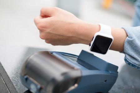 paying: Customer paying through smart watch