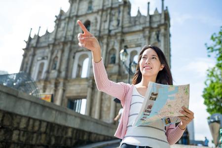 korean woman: Woman holding city map Stock Photo