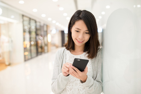 japanese people: Woman use of cellphone inside shopping center