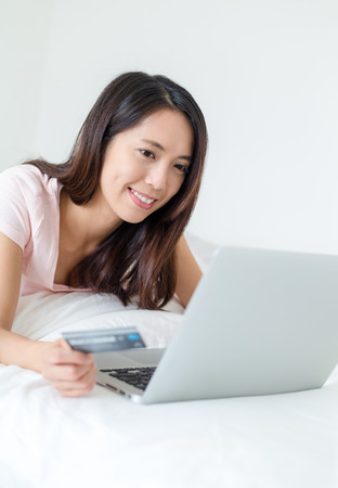 chinese lady: Woman using laptop computer for online shopping Stock Photo