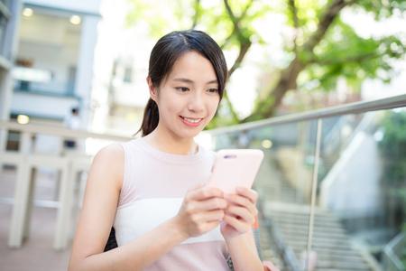 woman on phone: Woman watching on phone