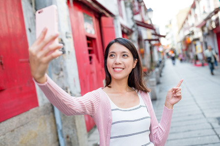 self image: Woman taking self image by cellphone in Macau Stock Photo