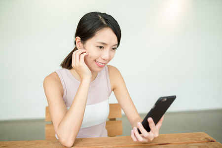 woman on phone: Woman hold with phone